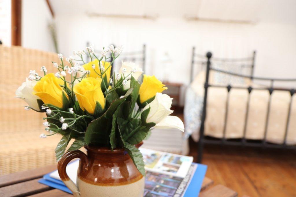 bed and breakfast room Top floor with vase of flowers
